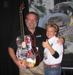 Marvin Benoit (L) and Traci Hrudka (R) share a smile after the guitar raffle drawing.